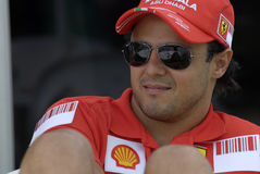 F1. Ferrari Formula One driver Felipe Massa of Brazil sits while talking at the Sepang Circuit in Sepang, Malaysia on Thursday Royalty Free Stock Images