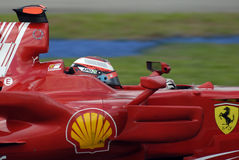F1. Very close up of kimi raikkonen while driving at malaysian grand prix Stock Images