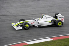 F1 Racing 2009 - Jenson Button (Brawn GP). Image of Jenson Button of the Brawn GP Team in action at the Formula 1 Petronas Malaysian Grand Prix held at Sepang Royalty Free Stock Photography
