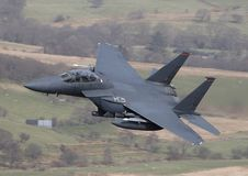 F15 Eagle. An F15 Eagle speeds through a Welsh Valley stock photos