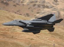 F15 Eagle. An F15 Eagle heads through a Welsh Valley in 2009 stock images
