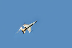 F16 fighter plane releasing infrared countermeasure decoy Royalty Free Stock Images