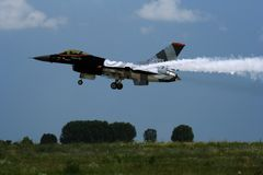 F16 jet fighter during landing. At an air show in Romania Stock Image