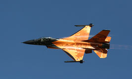 F16 Netherlands spectacular display colours. Spectacular orange Dutch royal air force F16 with looky the lion motif on the wings Royalty Free Stock Images