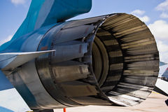 F16 Rear Engine. The rear engine of a F16 Thunderbird parked at a military base Royalty Free Stock Images