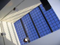 F85 Barred Skylight. Security skylight and blue skies beyond Stock Photos