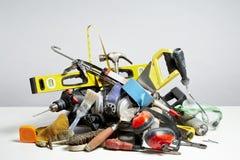 Faça-o você mesmo ferramentas na pilha no fundo branco Fotografia de Stock