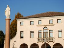 Façade of the building that houses the City Hall Conselve in the sun in the province of Padua in Veneto (Italy). Photo made at the façade of the building stock photo