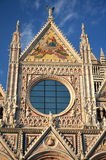 Façade of magnificent marble cathedral in Siena, Italy Stock Photo