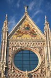 Façade of magnificent marble cathedral in Siena, Italy Stock Photos