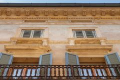 Façade of an old residential building. Old Façade of an residential building with windows and shutter in the Italian city of Verona stock photography