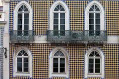 Façade vérifiée de modèle d'un bâtiment traditionnel Photographie stock libre de droits