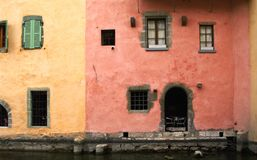 Façades of houses. Yellow and red façades of old houses in annecy in french alps Royalty Free Stock Image
