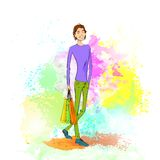 Façonnez l'homme occasionnel de achat avec le sac au-dessus de coloré Photographie stock
