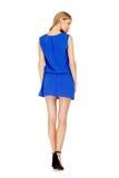 Façonnez la photo de la robe de port de jeune femme magnifique Photographie stock