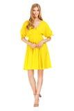 Façonnez la photo de la robe de port de jeune femme magnifique Photo stock