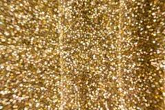 A faísca colorida e o bokeh blowcolourful iluminam-se na cor dourada t Imagem de Stock Royalty Free