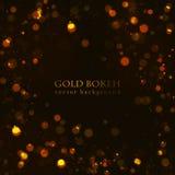 A faísca mágica, ouro pontilha no fundo escuro Foto de Stock