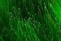 Faíscas abstratas interessantes do verde do fundo Imagens de Stock