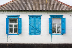 Faсade old hous with windows. Old house wall with wooden windows royalty free stock image