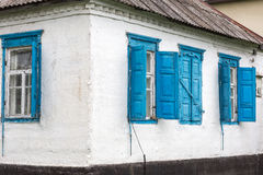 Faсade old house with windows. Old house wall with wooden windows stock photo