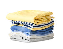 Fałdowi stert ubrania odizolowywający na bielu Obrazy Stock