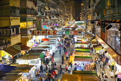 Fa Yuen Street, Hong Kong. Fa Yuen Street vendors selling products on the road between the buildings. It is lined with clothing, fruit, toy and sportswear in Royalty Free Stock Photo