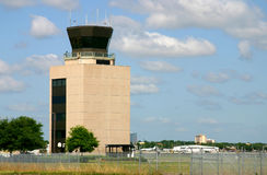 FAA Control Tower; Orlando Executive. FAA airport control tower, Orlando Executive Airport, Florida. Building is framed against gently clouded blue skies and stock photo