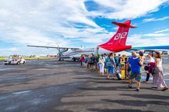 Happy tourists boarding Air Tahiti ATR 72 from Papeete, French Polynesia, Oceania. royalty free stock photography