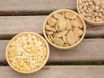 Fabaceae in the clay dishes. Dried fabaceae:beans and chick-peas in the clay dishes Royalty Free Stock Photography