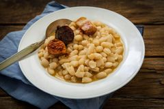 Spanish beans fadaba dish. Fabada is a typhical spanish legumes dish with big beans and sausage Stock Images