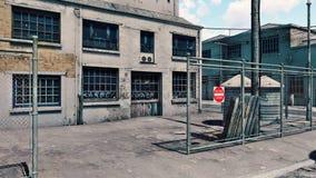 Fabbrica abbandonata in un distretto dei bassifondi Immagine Stock