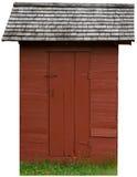 Fabbricato annesso rosso d'annata dell'azienda agricola isolato immagine stock