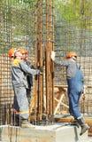 Fabbricazione degli operai di costruzione Immagine Stock