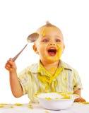 Bambino che gode del suo pranzo Fotografia Stock Libera da Diritti