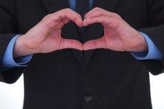 Fabbricazione del segno del cuore fotografia stock