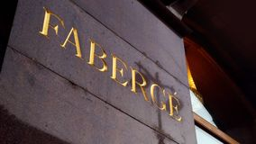 Faberge sign, carved on the granite wall royalty free stock photos