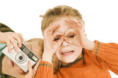 Fabian imitate glasses. Two little boys playing with a camera and imitate glasses with hands Royalty Free Stock Images