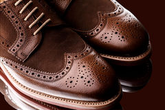 Fabolous two tone men brogue closeup. Unworn, laced pair of two tone men brogues (derbys) with elegant toe shape. The upper is stunning combination of brown calf Royalty Free Stock Photography
