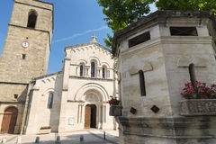 Fabregues (France). Fabregues (Herault, Languedoc-Roussillon, France), historic village near Montpellier: church and fountain royalty free stock image