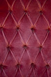 Fabric. Luxury red fabric texture on an old sofa Stock Image