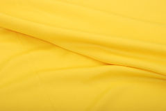 Fabric. Background of soft yellow silk fabric Royalty Free Stock Photo