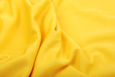 Fabric. Background of soft yellow silk fabric Stock Photo