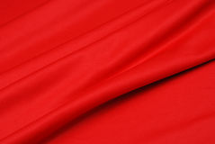 Fabric. Background of soft folded red silk fabric Royalty Free Stock Photos