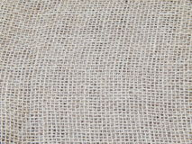 Fabric as a background. A piece of a bagging as a background. Closeup and texture Royalty Free Stock Photography