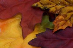 Fabric Autumn Leaves Background. Background close-up of loose fabric autumn leaves stock image
