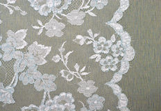 Fabric background. Blue and white lace on the fabric Royalty Free Stock Photography
