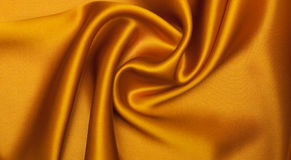 Fabric background. Smooth elegant orange silk can use as background Royalty Free Stock Photo