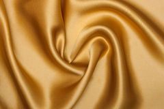 Fabric background. Smooth elegant yellow silk can use as background Stock Image