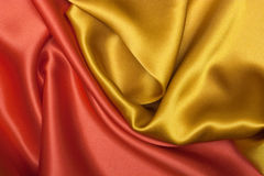 Fabric background. Elegant and soft red and yellow satin background Royalty Free Stock Image